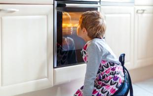 Kid in front of oven